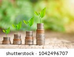 tree growing on coins stack... | Shutterstock . vector #1042496707