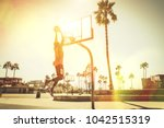 basketball slam dunk on a... | Shutterstock . vector #1042515319
