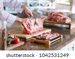 a man cook cuts meat with a...   Shutterstock . vector #1042531249