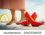 fashion and footwear. red high... | Shutterstock . vector #1042534435