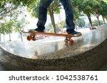 young skateboarder legs riding... | Shutterstock . vector #1042538761