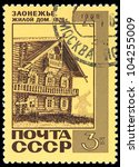 USSR - CIRCA 1968: A post stamp printed in USSR and shows old wooden house (1876) in northern russian village, series, circa 1968 - stock photo