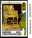CENTRAFRICAIN - CIRCA 1978: A stamp printed in The Central African Empire showing the image of a throne, series is devoted to Egyptian Pharaoh Tutankhamun, circa 1978 - stock photo