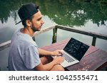 freelancer with laptop on the... | Shutterstock . vector #1042555471