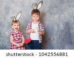 two children  a girl and boy... | Shutterstock . vector #1042556881