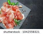 italian prosciutto crudo or... | Shutterstock . vector #1042558321