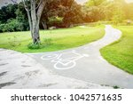 white bicycle way sing in bike... | Shutterstock . vector #1042571635