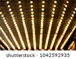 Small photo of Rows of illuminated globes under the marquee as often used at entrance to theatres and casinos
