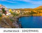 assos village in cephalonia... | Shutterstock . vector #1042594441