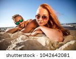 summer time on beach and two... | Shutterstock . vector #1042642081