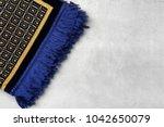 muslim prayer rug on gray... | Shutterstock . vector #1042650079