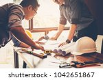 engineers and businessmen are... | Shutterstock . vector #1042651867