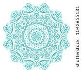 mandala on a white background.... | Shutterstock .eps vector #1042655131