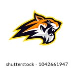 charismatic angry tiger head in ...   Shutterstock .eps vector #1042661947