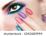 colorful bright makeup on brown ... | Shutterstock . vector #1042683994