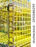 lobster pots in fishing village   Shutterstock . vector #1042686295