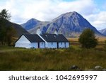 a white cottage near glencoe on ... | Shutterstock . vector #1042695997