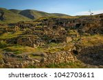 ancient houses in caves in the... | Shutterstock . vector #1042703611