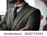 detail of man in custom... | Shutterstock . vector #1042715431