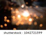 bokeh light from sparks  labour ... | Shutterstock . vector #1042721599