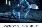 astronaut collect rock and soil ...   Shutterstock . vector #1042736344