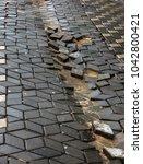 damaged asphalt road with... | Shutterstock . vector #1042800421