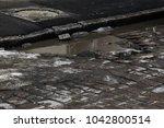 damaged asphalt road with...   Shutterstock . vector #1042800514