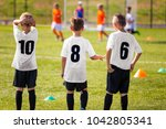 children football team. young... | Shutterstock . vector #1042805341