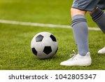 football detail. kicking the... | Shutterstock . vector #1042805347