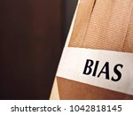"""Small photo of Close up of Tan Color Bias Tape with Label that says """"Bias"""""""
