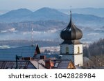 rooftops of houses and the... | Shutterstock . vector #1042828984