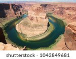 Small photo of Green and iridescent shadings in Colorado River Horseshoe Bend, Page, Arizona. Slow work of erosion on a bright August 2015 day.