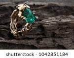 gold ring with emerald on a... | Shutterstock . vector #1042851184