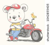 cute bear near the motorcycle...