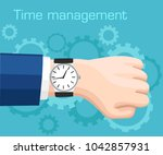 wristwatch on the hand of... | Shutterstock .eps vector #1042857931