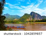 tour boats in mekong river ... | Shutterstock . vector #1042859857
