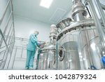 pharmaceutical factory woman... | Shutterstock . vector #1042879324