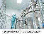 pharmaceutical factory woman... | Shutterstock . vector #1042879324