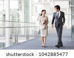 asian business group talking in ... | Shutterstock . vector #1042885477