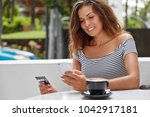 portrait of cheerful woman with ... | Shutterstock . vector #1042917181