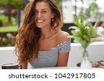 happy smiling woman feels... | Shutterstock . vector #1042917805