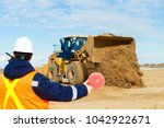 during leveling construction... | Shutterstock . vector #1042922671