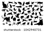 Stock vector set of silhouettes of the cats and the paw prints vector illustrations isolated on white 1042940731