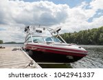 a wakeboard boat at a wooden... | Shutterstock . vector #1042941337