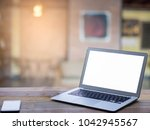 close up blank laptop with... | Shutterstock . vector #1042945567