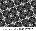 ornament with elements of black ...   Shutterstock . vector #1042957225