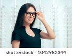 woman wearing eyeglasses in... | Shutterstock . vector #1042982344