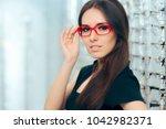 woman wearing eyeglasses in... | Shutterstock . vector #1042982371