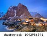 houses in the lofoten islands... | Shutterstock . vector #1042986541