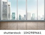 empty office room with wooden... | Shutterstock . vector #1042989661